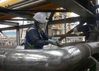 Contour Installers Prepare Pipe Surface