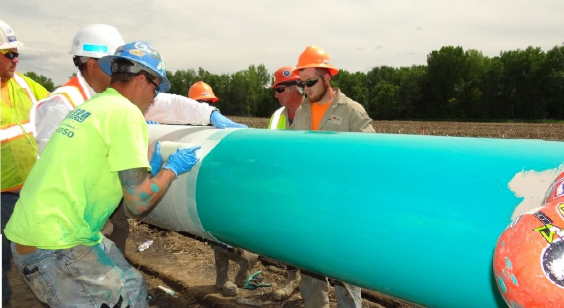 team prepares a 300-ft (91-m) section of pipe with Scar-Guard