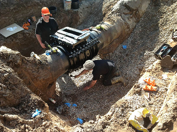 Workers prepare to install permanent AVT valves.